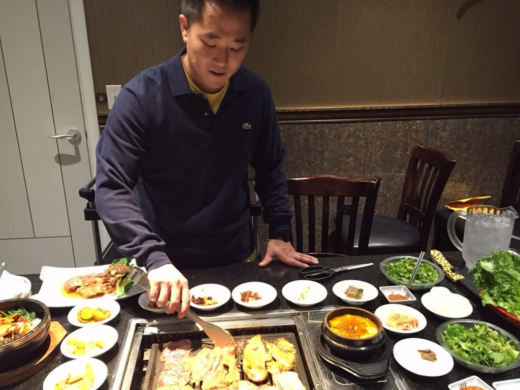 Mark Moon, who has taken over Seoul BBQ & Sushi from his parents, demonstrates how to grill the restaurant's authentic Korean BBQ at the table. Photo credit: Ronni Newton