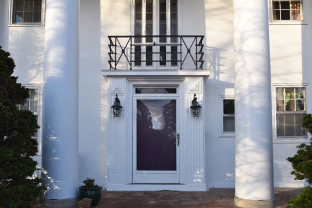 Detail of the home's entry including the balcony. Love the wrought iron railing! Photo credit: Deb Cohen