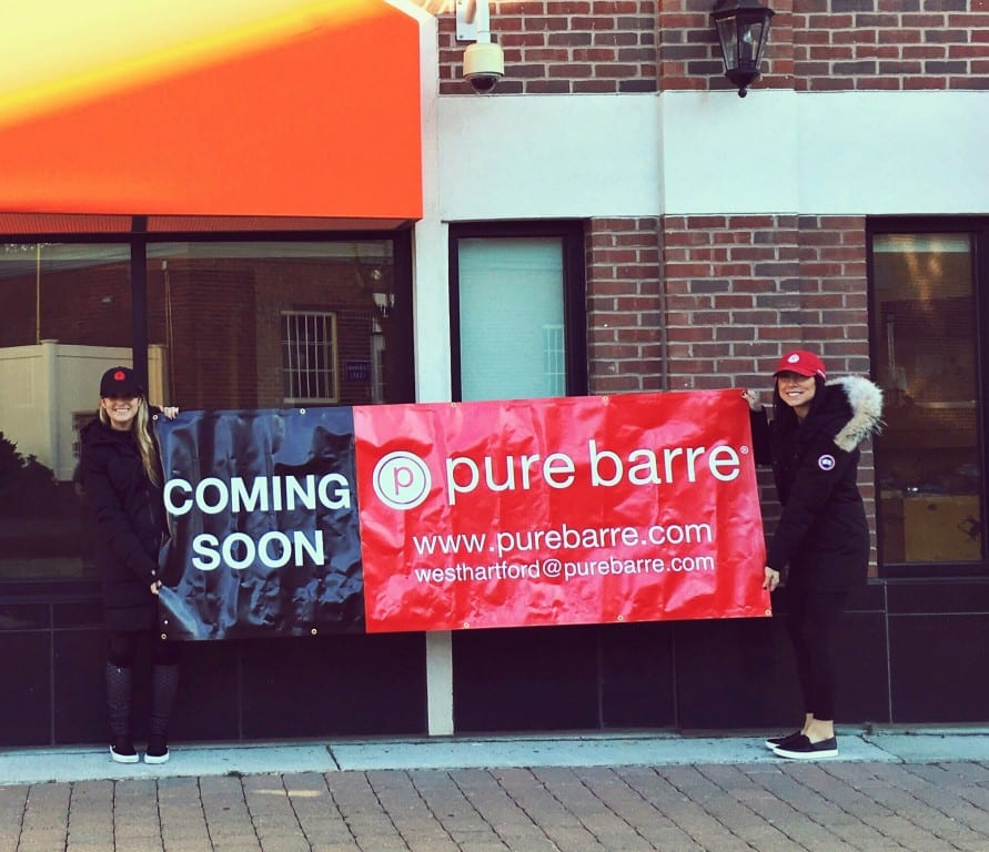 Stephanie Lin (right) and one of her instructors stand in front of the soon-to-open Pure Barre fitness studio in West Hartford's Blue Back Square. Courtesy photo