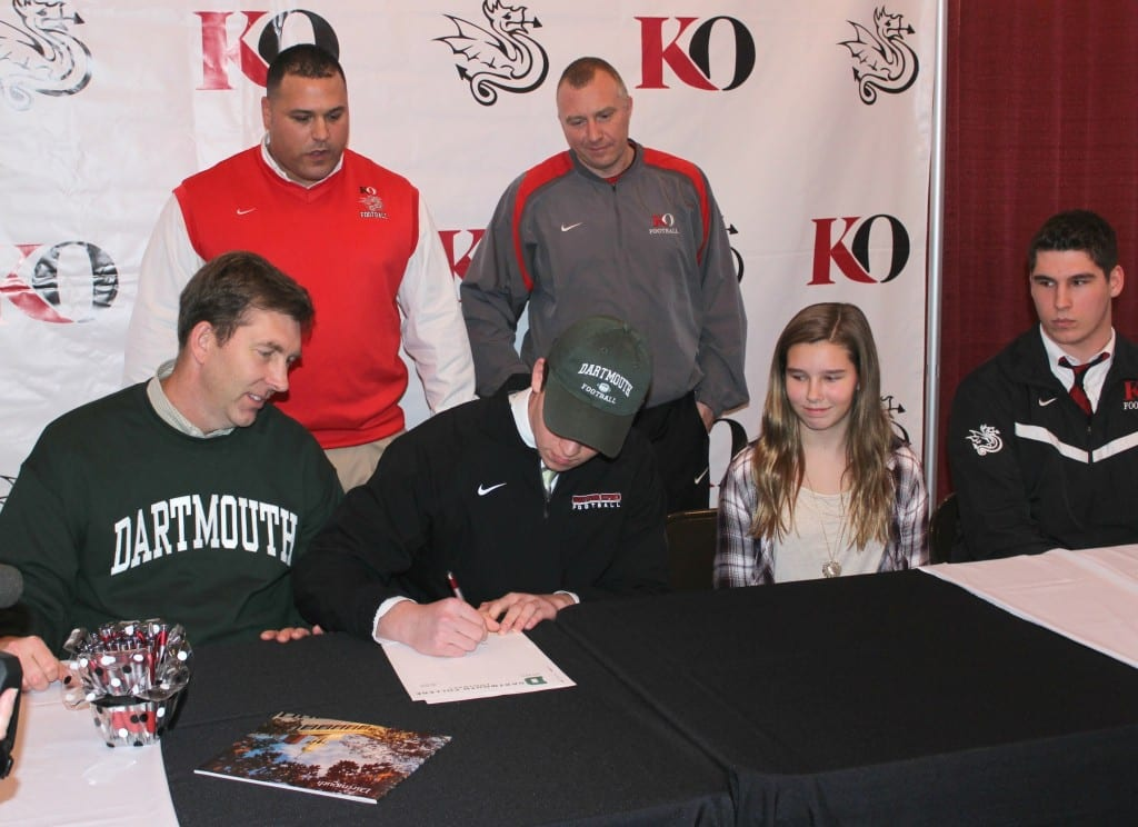 Andrew Lemkuil signs his letter to play football at Dartmouth College. Photo credit: Michelle Murphy