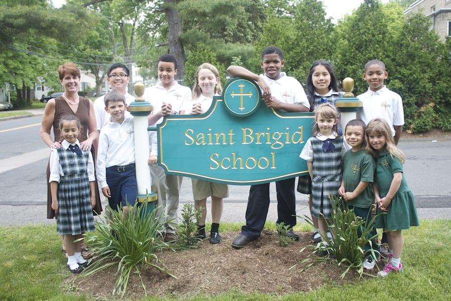 Saint Brigid School Principal Shevon Hickey with students from the West Hartford Catholic school. File photo
