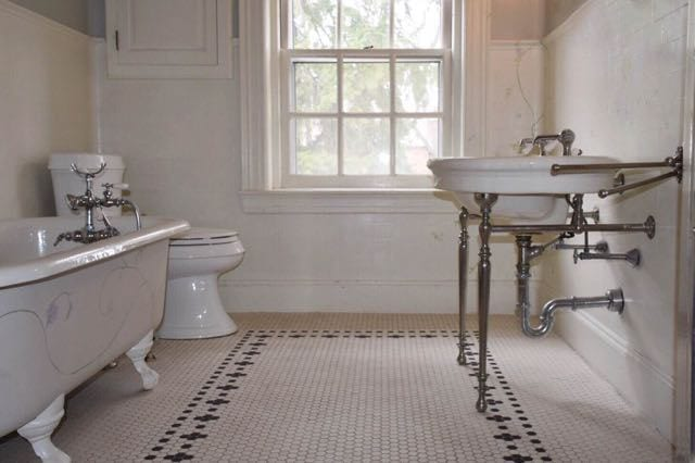Detail of the charming vintage bath with original flooring, sink, and tub. Photo credit: Deb Cohen