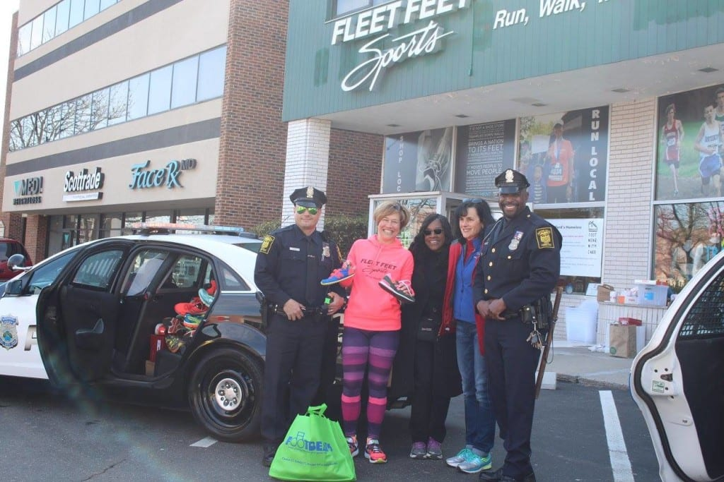 Footwear with Care team (from left): Officer Otero, Stephanie Blozy, Deb Barrows, Abby Moore, Officer Jimmy Barrett. Courtesy photo
