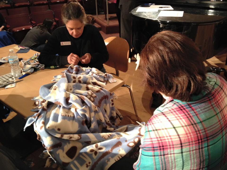 Project Linus blankets being made at the January GMM. Submitted photo