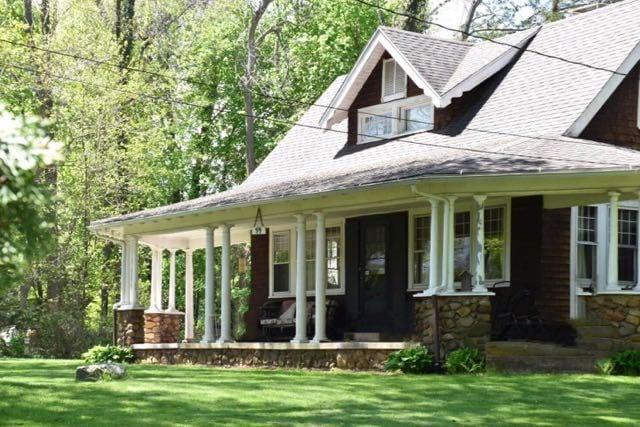 An expansive porch wraps around this unique home. Photo credit: Deb Cohen