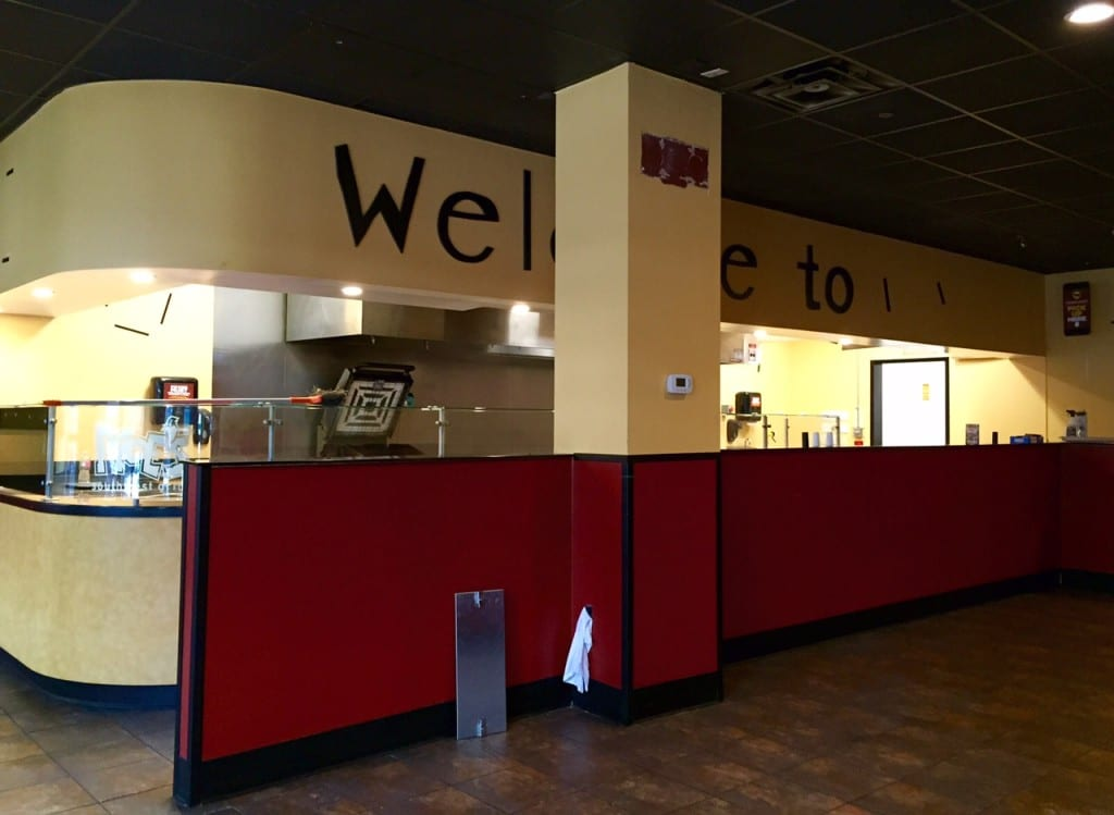 """The """"Welcome"""" sign was one of the few things that remained inside Moe's on Friday. Photo credit: Ronni Newton"""