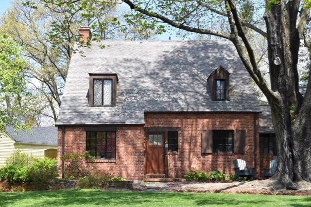 Tudor-style influences the windows and brickwork on this charming home. Photo credit: Deb Cohen