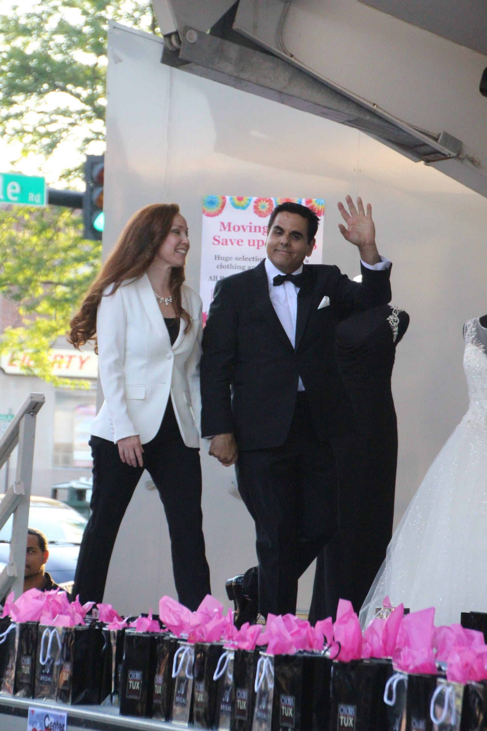 Oscars TUX owners Kelli and Oscar Sosa enter the stage during the Fashion Show in West Hartford Center on the Town of West Hartford Showmobile stage on June 23, 2016. Photo credit: Dylan Carneiro