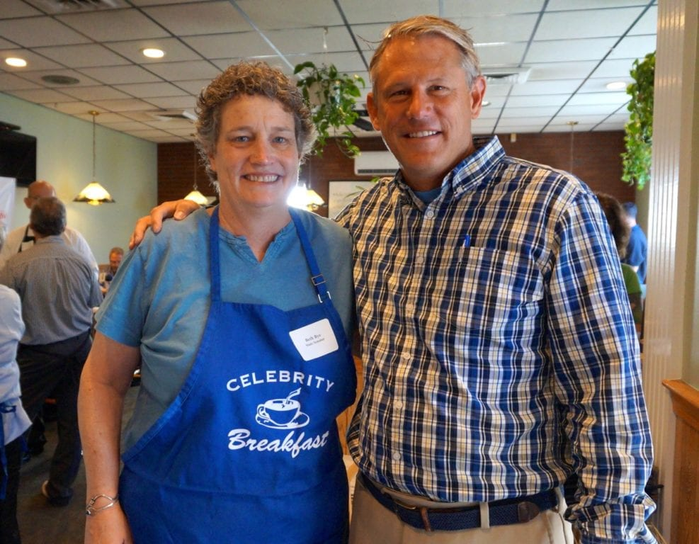 State Sen. Beth Bye (D-5th district) prepares to serve State Sen. Kevin Witkos (R-8th district), who was visiting from Canton. Celebrity Breakfast. June 14, 2016. Photo credit: Ronni Newton