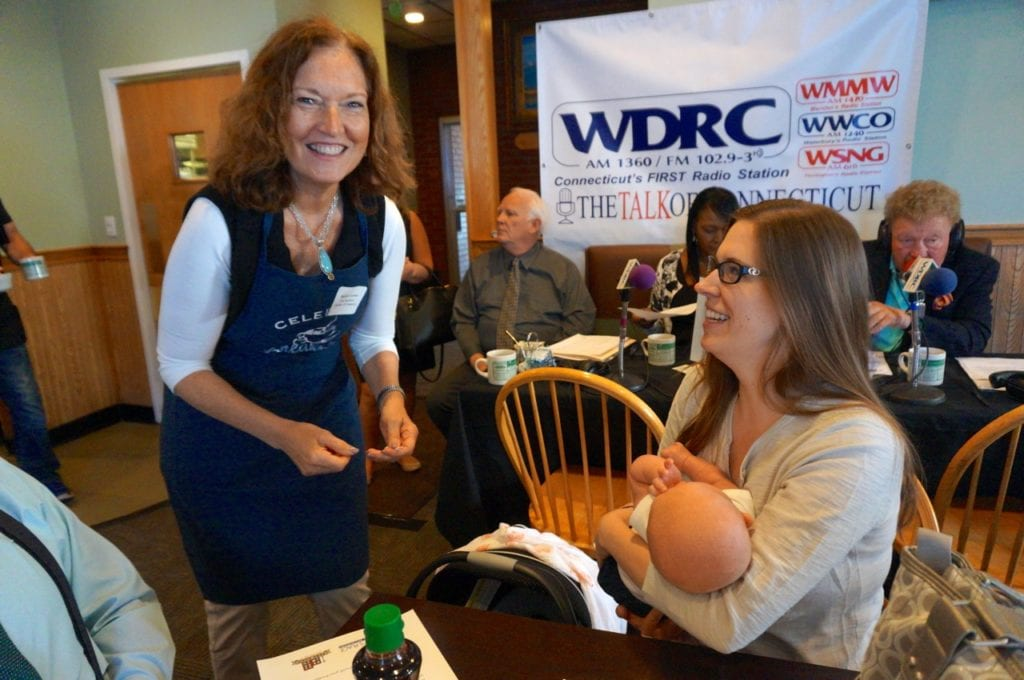 Chamber of Commerce Executive Dir. Barbara Lerner (left) takes an order from West Hartford Press Executive Editor Abigail Albair, who brought her infant son, Leo. Celebrity Breakfast. June 14, 2016. Photo credit: Ronni Newton