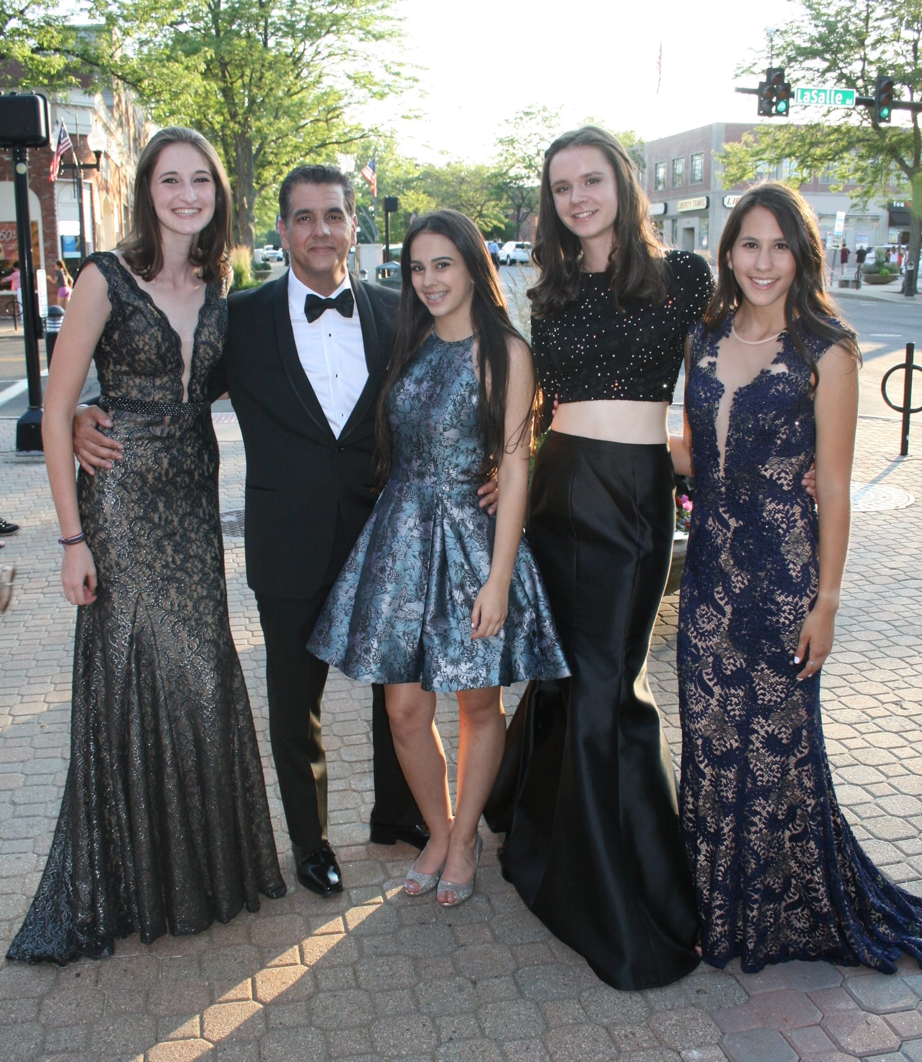 """Ody Sosa, owner of Argelia Novias Bridal, with his """"models"""" at the Fashion Show in West Hartford Center on the Town of West Hartford Showmobile stage on June 23, 2016. Photo credit: Joy Taylor"""