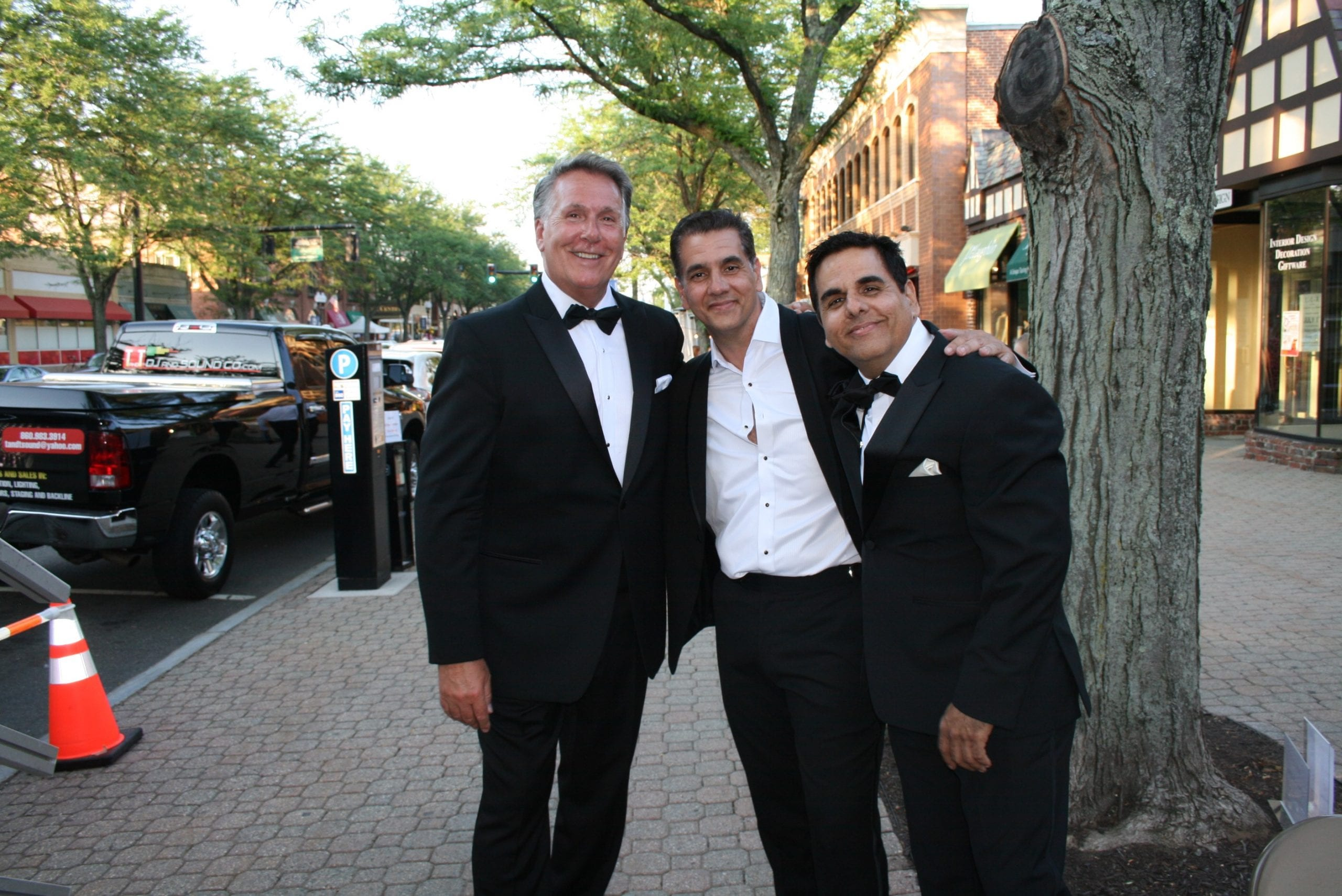Co-hosts Tom Hickey, Ody Sosa and Oscar Sosa at the Fashion Show in West Hartford Center on the Town of West Hartford Showmobile stage on June 23, 2016. Photo credit: Joy Taylor