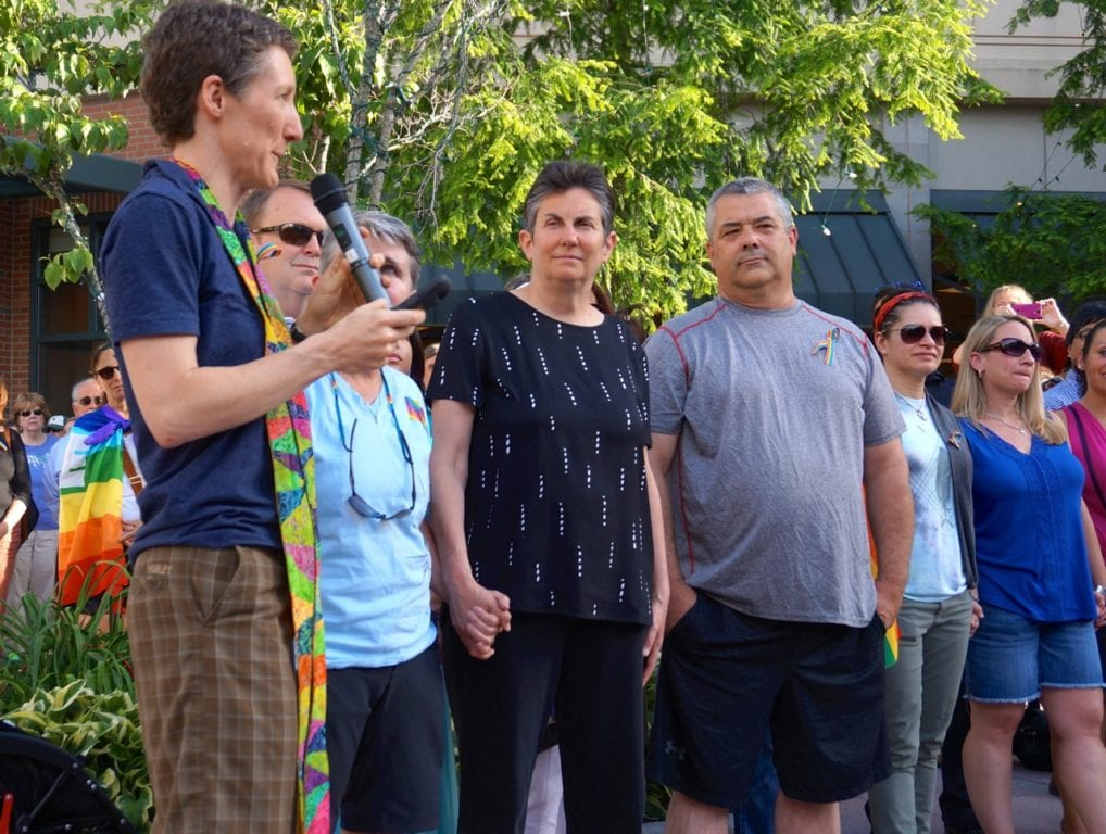 Cathy Rion Starr (left) of the Unitarian Church of Hartford speaks directly to those who came forward as members of the LGBT community. Vigil, June 15, 2016. Photo credit: Ronni Newton