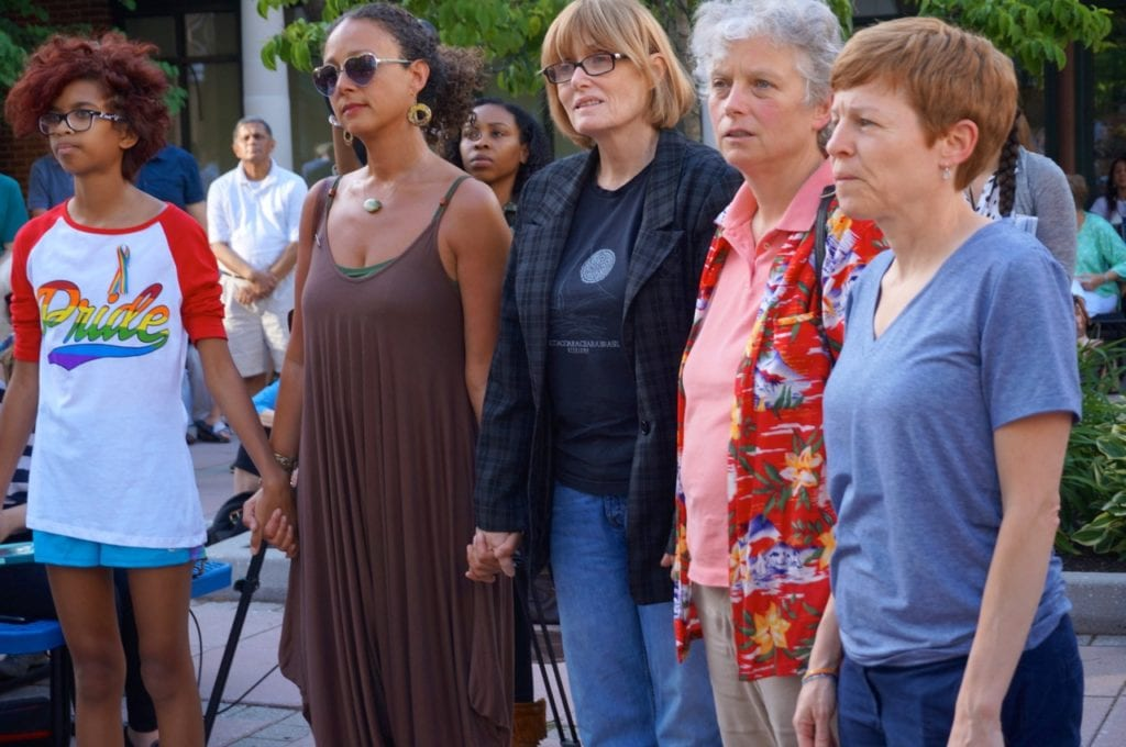 At the request of Rev. Cathy Rion Starr, members of the LGBT community come forward and stand in a circle, holding hands. Vigil, June 15, 2016. Photo credit: Ronni Newton
