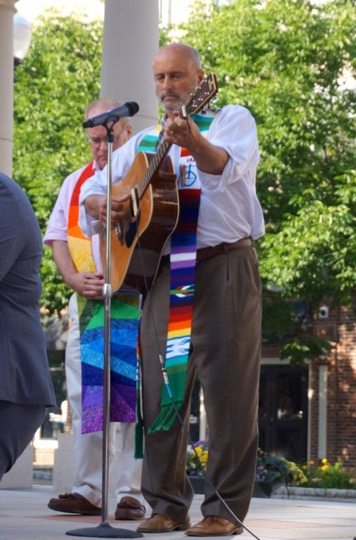 Mark Diters of Flagg Road UCC leads the singing of Pete Seeger's 'Where Have All the Flowers Gone.' Vigil, June 15, 2016. Photo credit: Ronni Newton