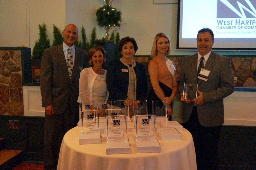 The economic development committee's Spotlight Award was presented to Mike Kijak (right) of Legrand Wiremold. Pictured are (from left) Dave Cailbey, Mayor Shari Cantor, Cindy Ciccheti, and Morgan Hilyard. Photo credit: Ronni Newton