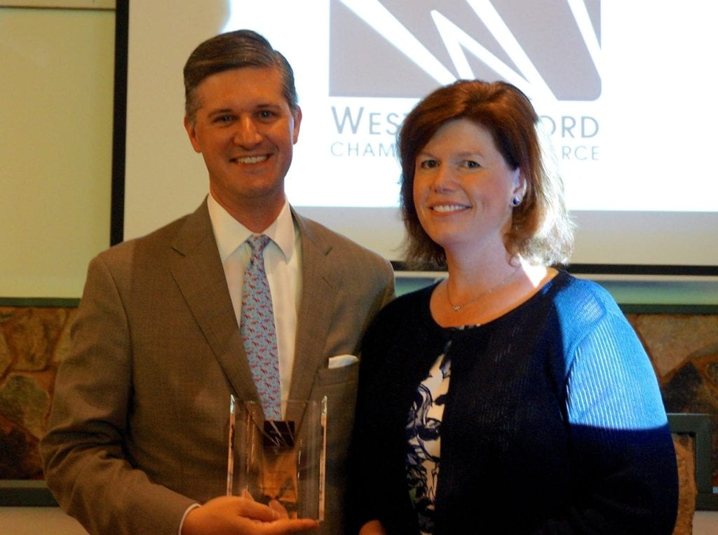 Former West Hartford Mayor Scott Slifka accepts the Chamber of Commerce's Noah Webster Award from Christine Looby at the Annual Dinner Monday night. Photo credit: Ronni Newton