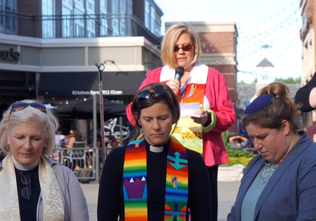 Rev. Stacy Emerson of First Baptist Church offers a prayer. Photo credit: Ronni Newton