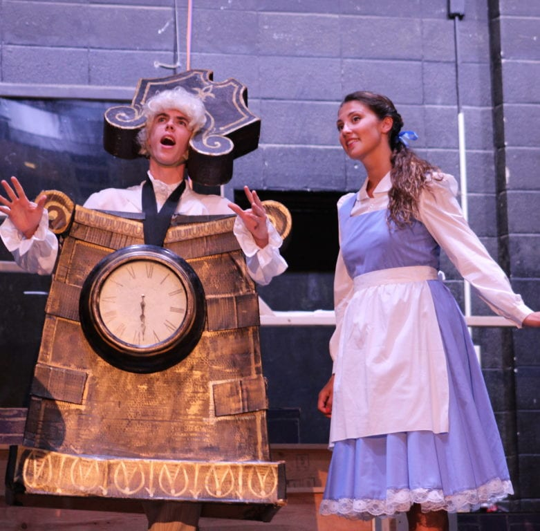 Cogsworth (Pat King) gives Belle (Gabrielle Baker) a tour of the castle. Photo credit: Emily Lafreniere
