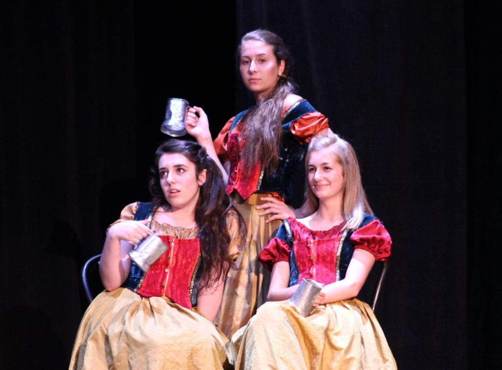 "Gaston's ""Silly Girls"" show their displeasure with his interest in Belle: Caroline O'Connell (left), Katie Kopp (right), and Kristin Weiss (back). Photo credit: Emily Lafreniere"