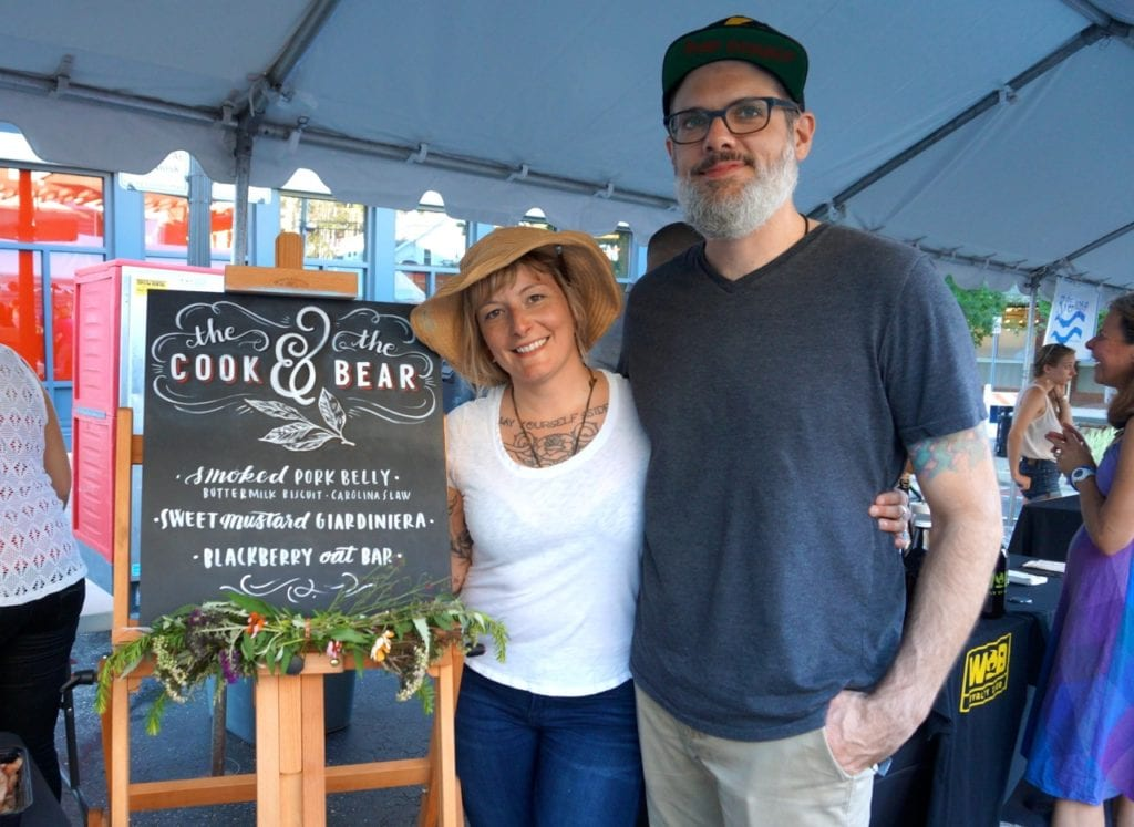 Chef Ed Jones (right) provided a preview of menu items from the soon-to-open Cook and the Bear. Jaime LaDucer, owner of Chalk Art New England, created the customized chalk board. Taste of Blue Back Square and The Center. July 27, 2016. Photo credit: Ronni Newton