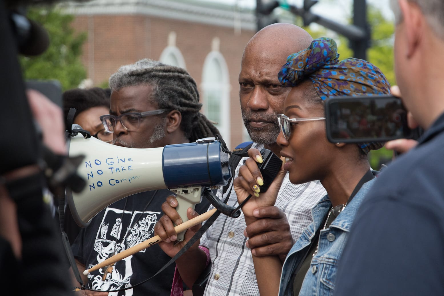 DeLisa Dixon has the floor during a Black Lives Matter rally in West Hartford, while Cornell Lewis holds the megaphone. With them is John L. Selders. Photo credit: Michaela Melvin