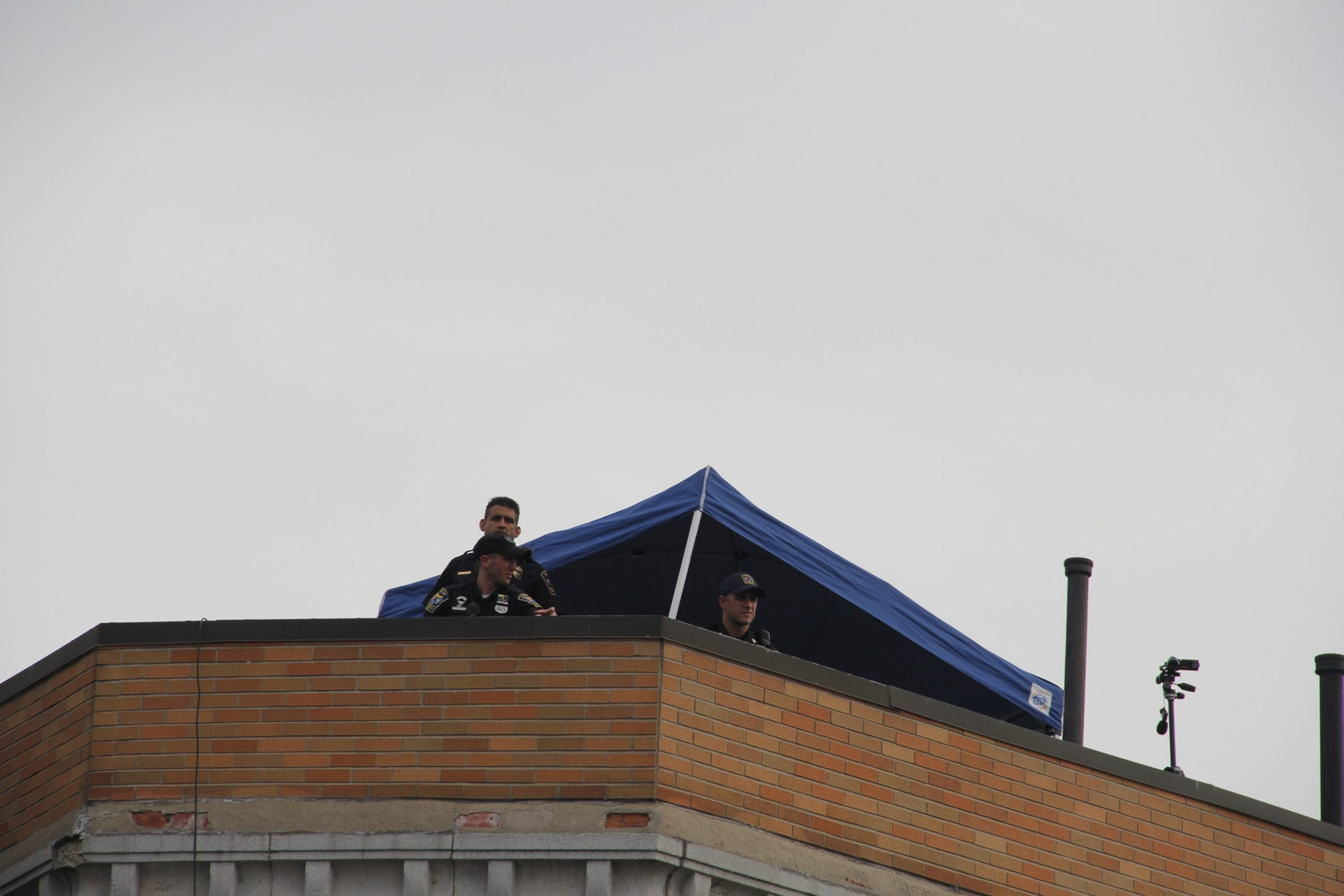 Police presence on the roof of Bruegger's Bagels during the Black Lives Matter rally in West Hartford. Photo credit: Amy B. Melvin