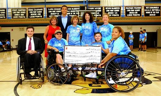 Pictured (L-R): Jonathan Slifka, Governor's liaison to the disability community; Lynn Ricci, FACHE, president & CEO, Hospital for Special Care; William Reeve, Christopher & Dana Reeve Foundation; Janeace Slifka, founder of Hospital for Special Care's Ivan Lendl adaptive sports camp; Michelle Milczanowski, grant writer, Hospital for Special Care; Janet Connolly, sports and community programs manager, Hospital for Special Care and 2016 campers. Submitted photo