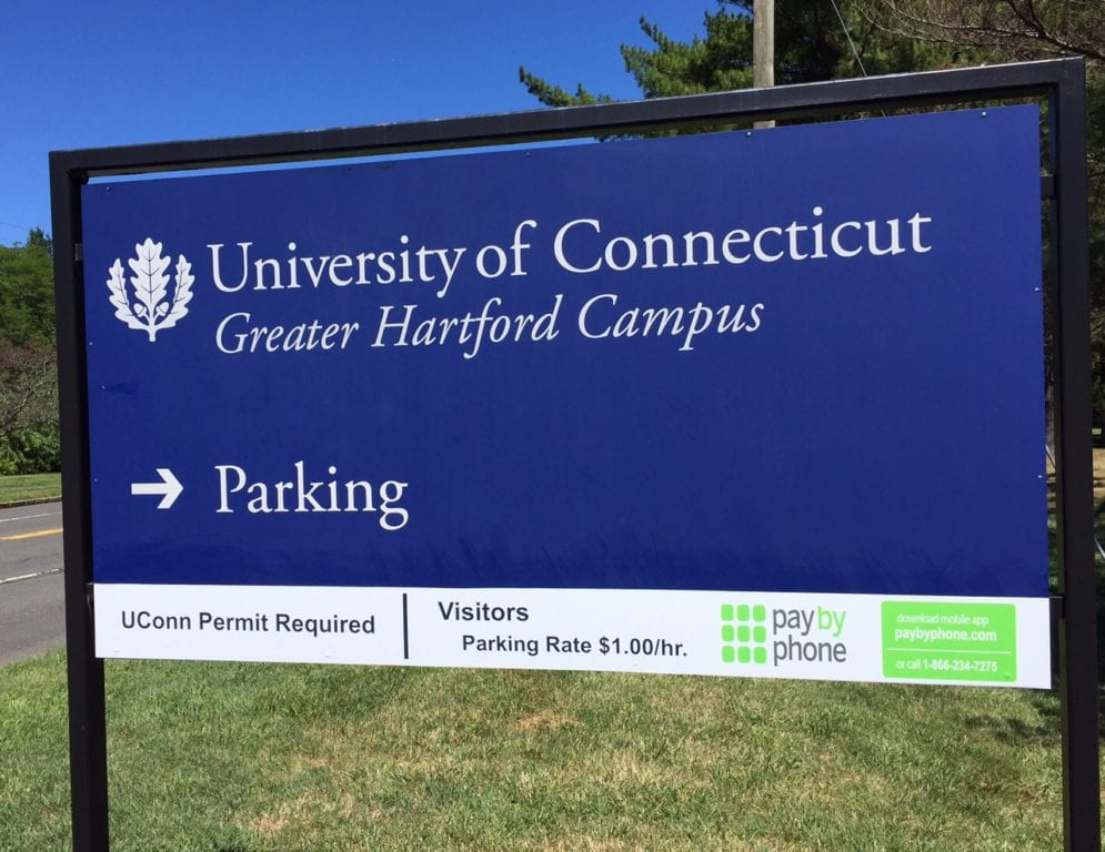 New signage at the entrance to the UConn parking lot on Trout Brook Drive indicate that visitors need to 'pay by phone' to park. Photo credit: Ronni Newton