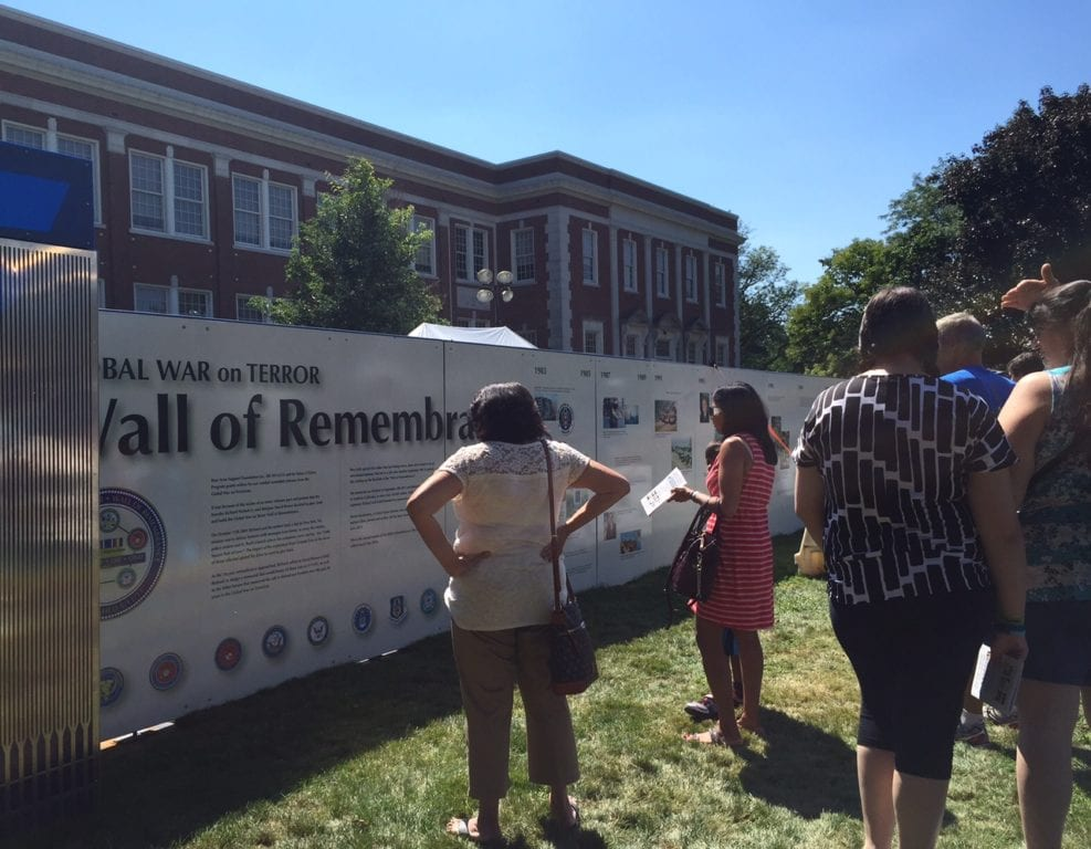 Many Center Streets participants also stopped to view the Wall of Remembrance on the lawn of West Hartford Town Hall. Photo credit: Ronni Newton