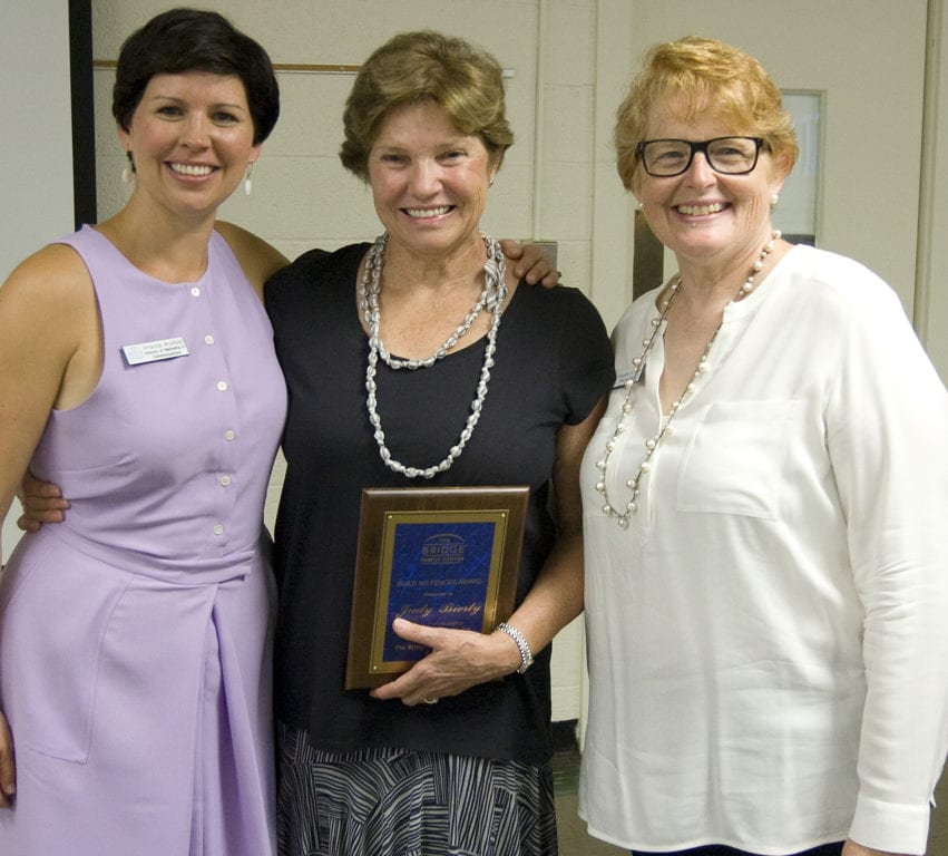 Judy Bierly (center) was awarded the Build No Fences Award Wednesday by The Bridge Family Center. At left is Director of Marketing and Communications Amanda Aronson. Executive Director Margaret Hann is at right. Courtesy photo