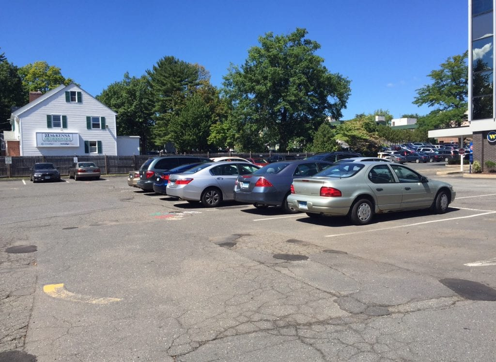 If the amendment to FAR is approved, Lexham will propose a residential development with ground floor retail/commercial occupancy for the current Webster Bank building parking lot. Photo credit: Ronni Newton