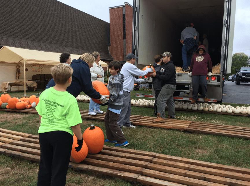 Volunteers unload 3,000 pumpkins on Saturday. Courtesy photo
