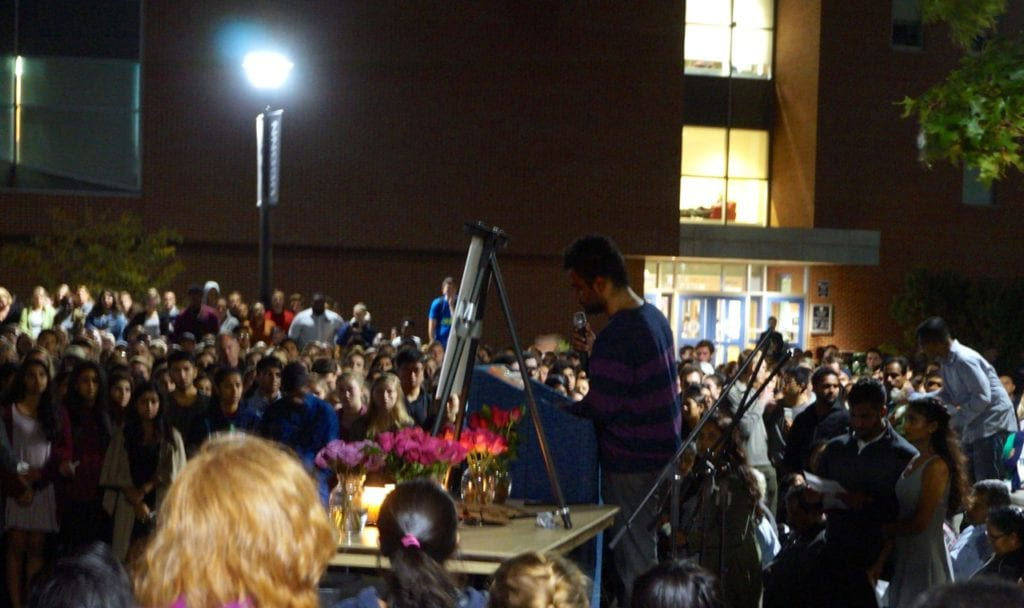 Jeffny Pally's cousin, Atul Sajan, addresses the crowd at a candlelight vigil at UConn. Photo credit: Ronni Newton