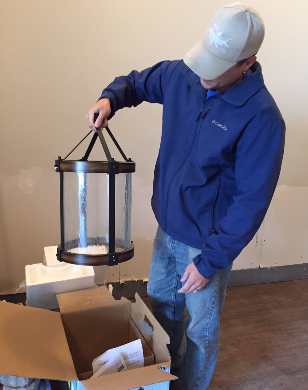 David Borselle holds up one of the new lights that is about to be installed at Park & Oak. Photo credit: Ronni Newton