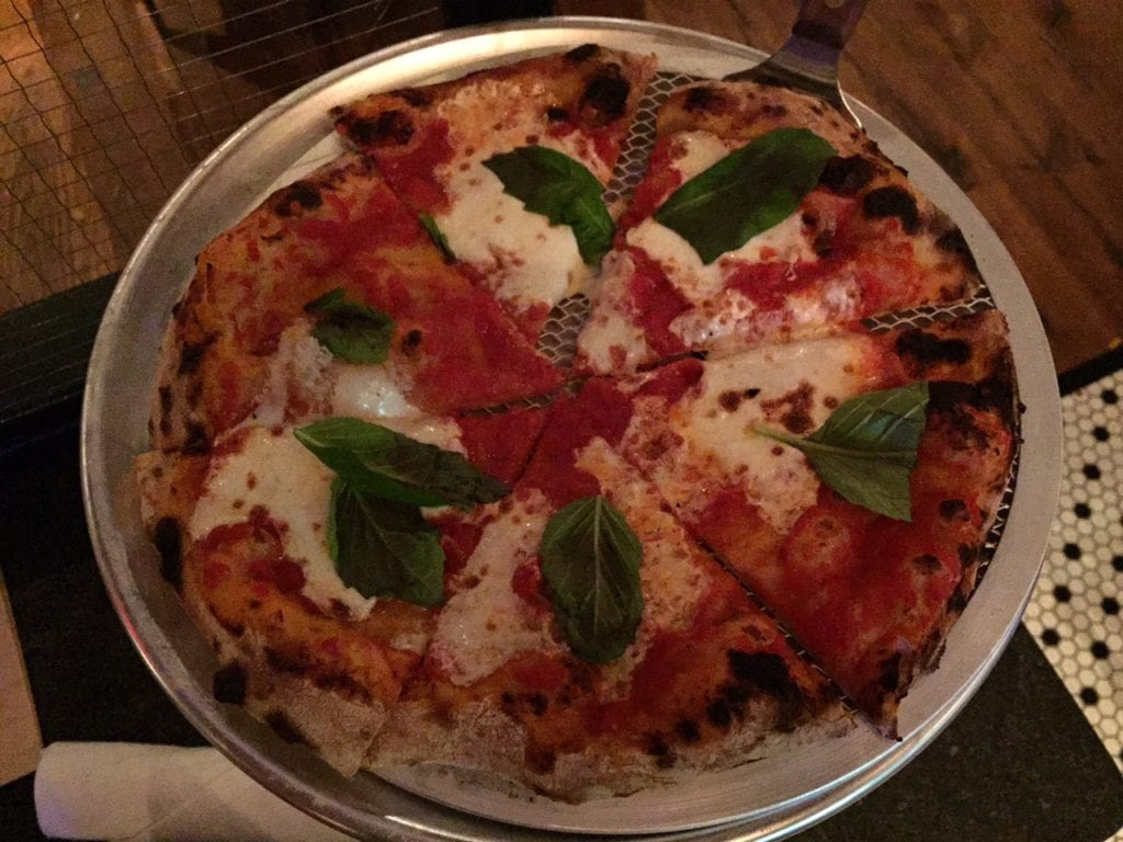 The Queen Margherita Pizza is Savoy's namesake, and lives up to its reputation with leaves of fresh basil and just the right amount of cheese. Photo credit: Ronni Newton