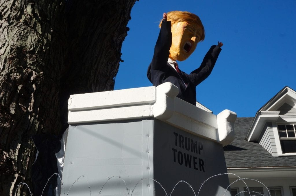 An image of Donald Trump in Trump Tower atop the 8-foot wall. Photo credit: Ronni Newton