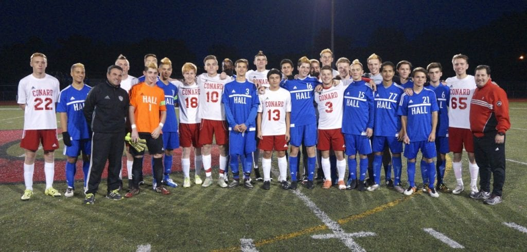 Seniors From Both Hall And Conard Pose With Their Coaches For A Photo Before The Game