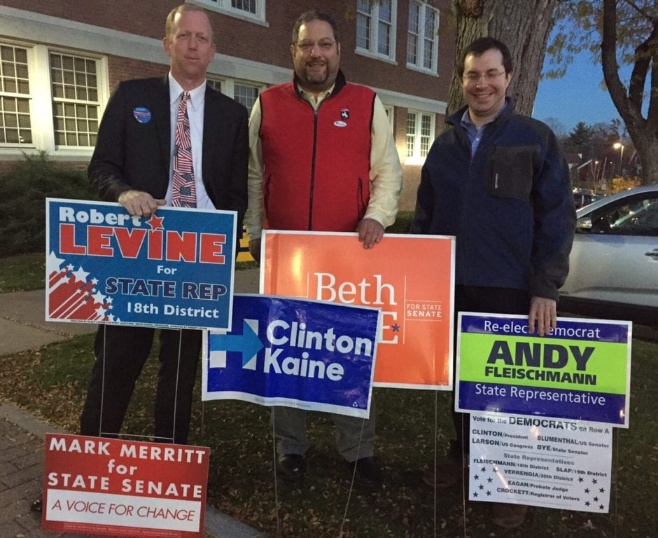 Rob Levine (left), the Republican candidate for State House District no. 18, stands outside West Hartford Town Hall with supporters for other local candidates. Photo credit: Ronni Newton