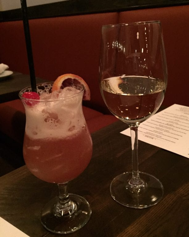 Hurricane and a glass of wine to accompany dinner at Park & Oak Restaurant. Photo credit: Ronni Newton