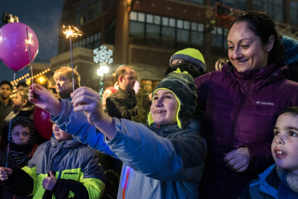 Participants join in joy, lighting up the night as the 8-foot Ice Menorah is lit. Submitted photo