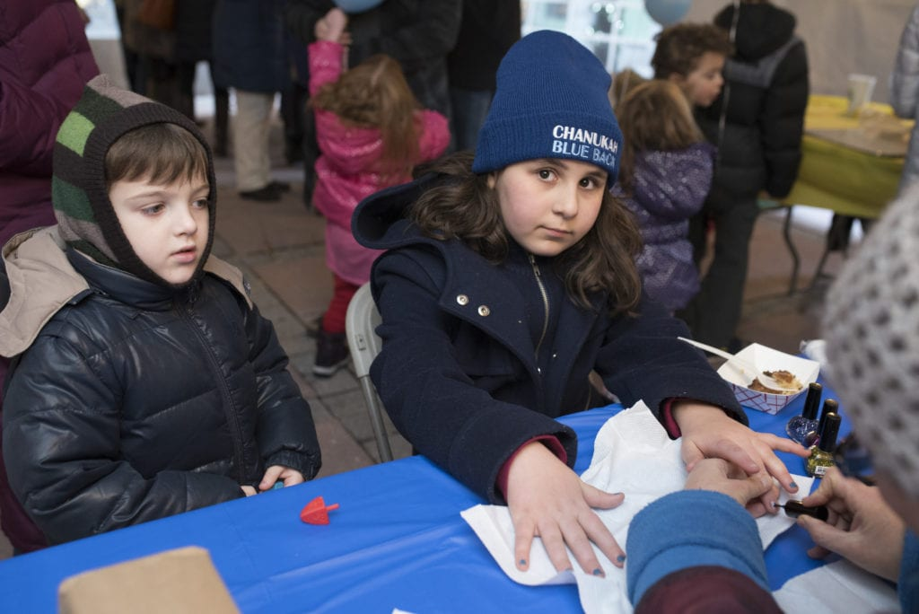 """Children enjoy """"Chanukah Nails"""" in the activity and craft tent in Blue Back Square. Submitted photo"""