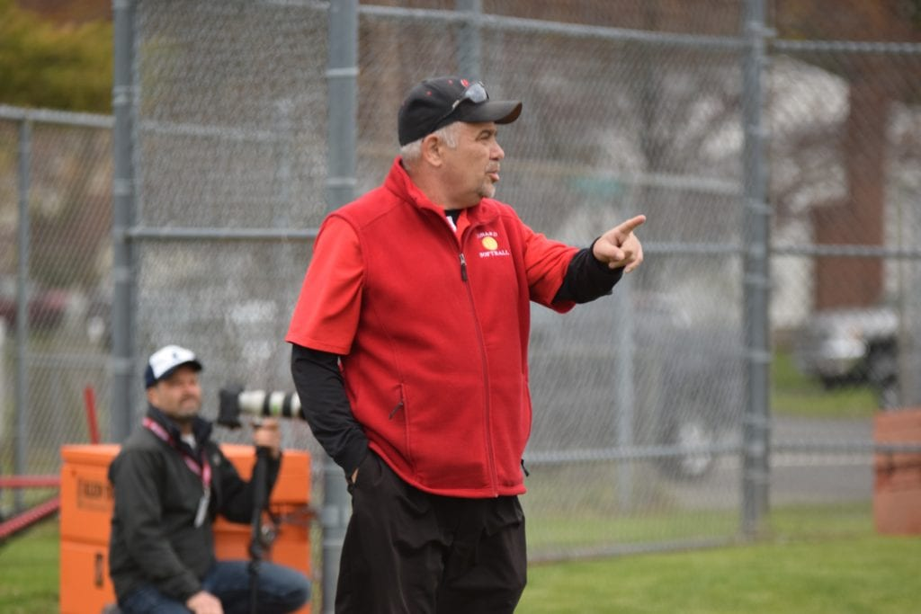 Tom Verrengia gives instructions to the Conard softball team. Photo courtesy of Theresa Lerner