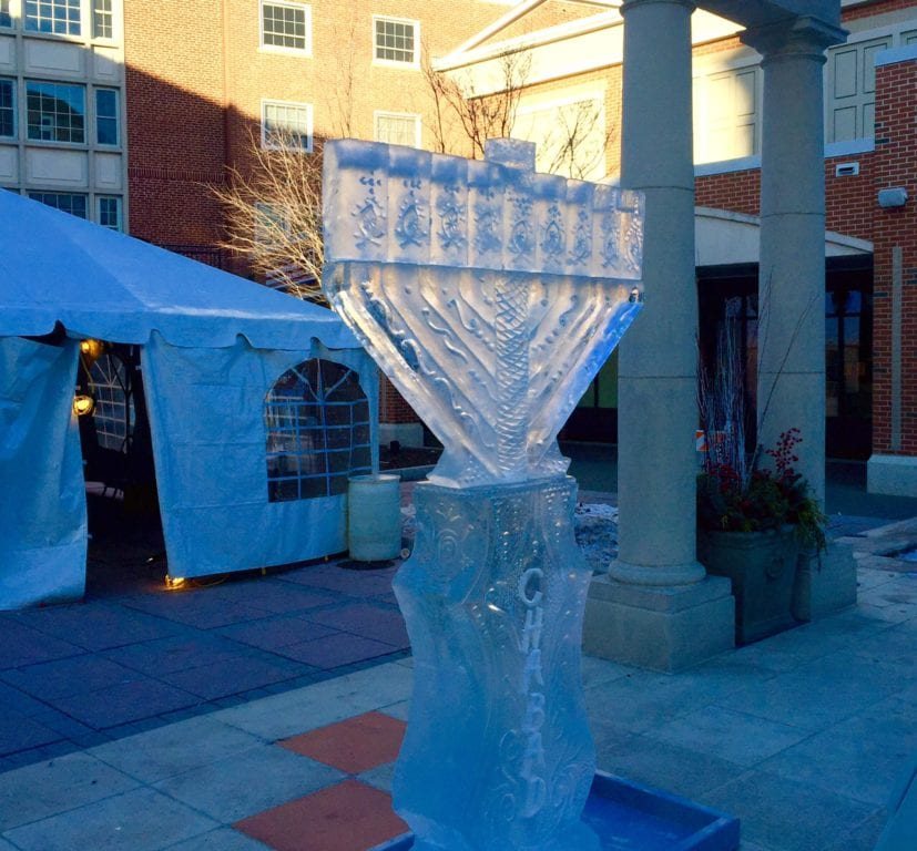 The ice menorah in Blue Back Square was carved and lit on Dec. 25, 2016, but removed the following day before it melted. Photo credit: Ronni Newton