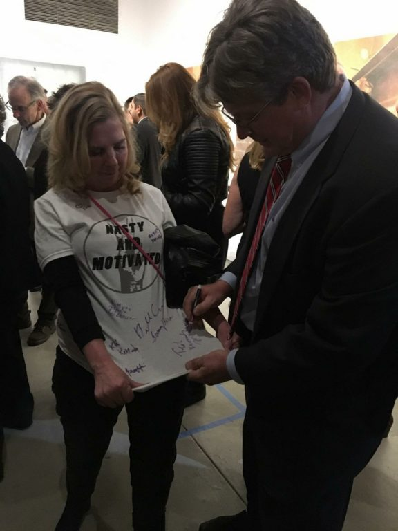 Essie Labrot gets her shirt signed by Ted Kennedy Jr. as she prepares to depart for Washington. Women's March on Washington. Photo courtesy of Essie Labrot