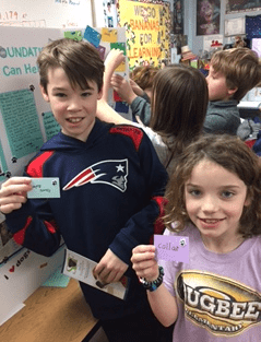 Max's classmates, Zachary Anderson and Maddie Peterson, select slips of paper with requested donations to the Simon Foundation. Courtesy photo
