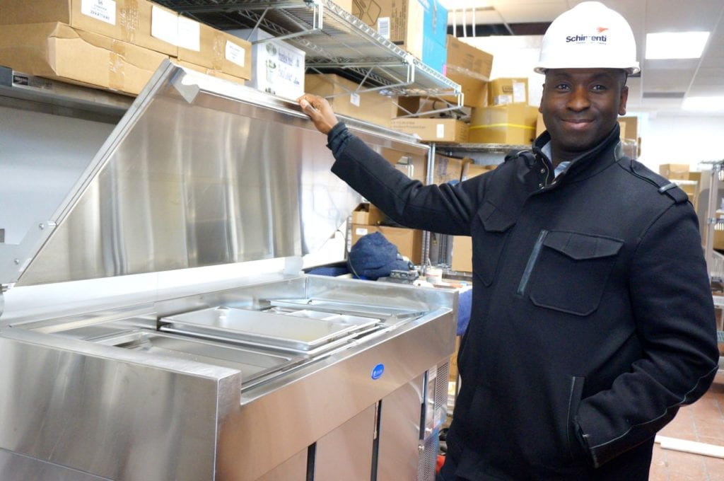 Daryl Jackson, owner/operator of the West Hartford Chick-fil-A, shows off the breading table – the heart of the kitchen. Photo credit: Ronni Newton