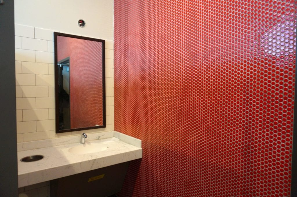 A red-tiled wall accents the ladies room at the West Hartford Chick-fil-A. Photo credit: Ronni Newton