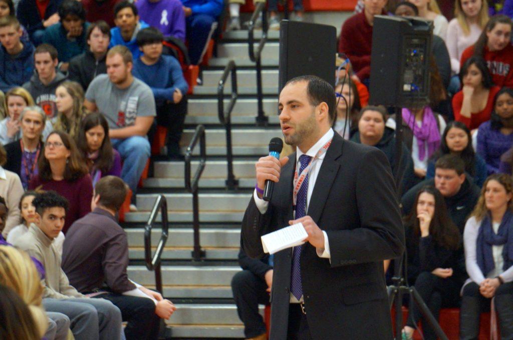 Conard Principal Julio Duarte introduces Chris Herren to the school community on Feb. 14, 2017. Photo credit: Ronni Newton