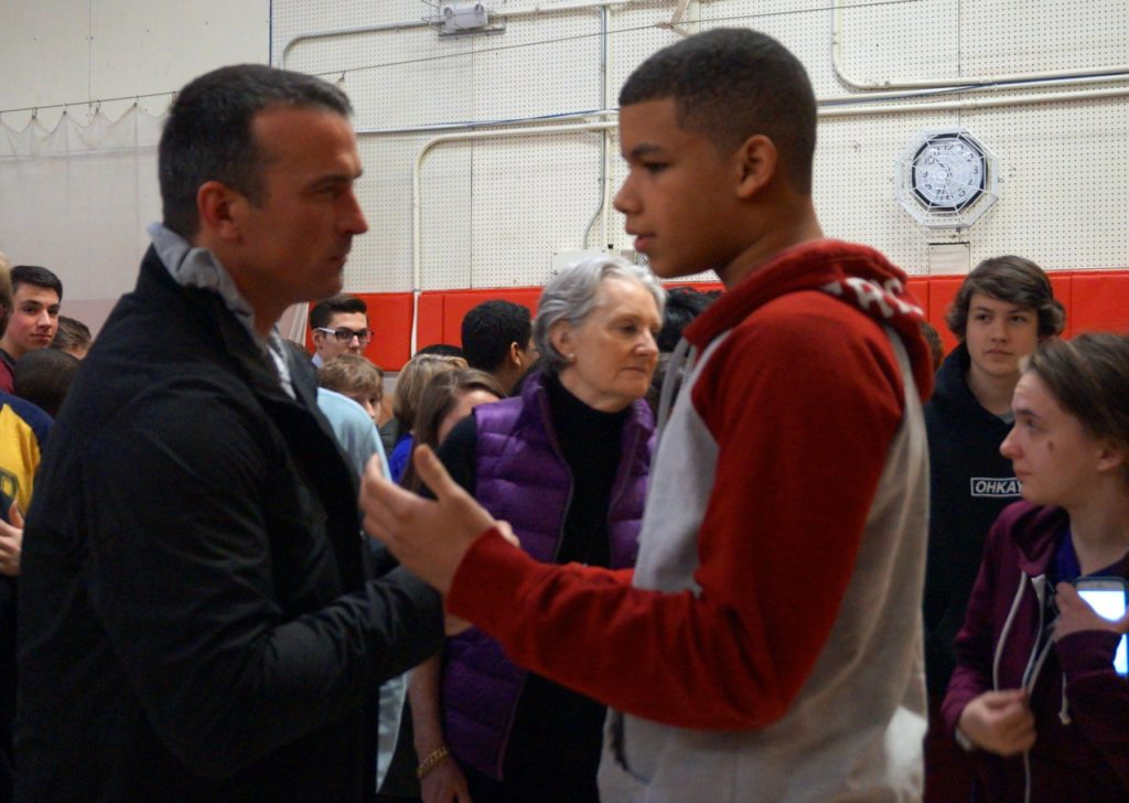 Basketball legend Chris Herren (left) has a one-on-one conversation with a Conard student after his Feb. 14, 2017 presentation to the entire school. Photo credit: Ronni Newton